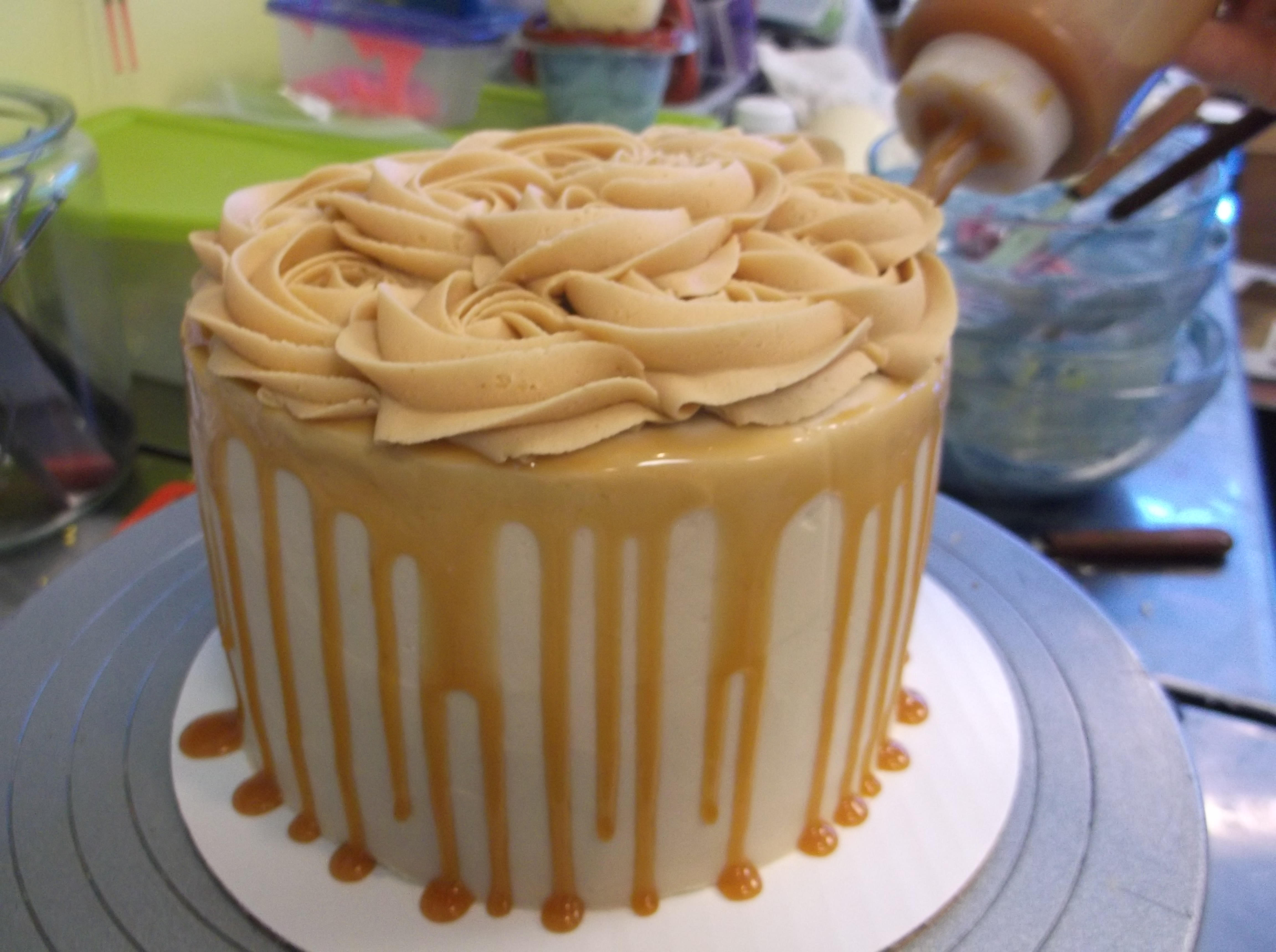Vanilla Layer Cake with Salted Caramel Frosting and Rose Swirl Top.